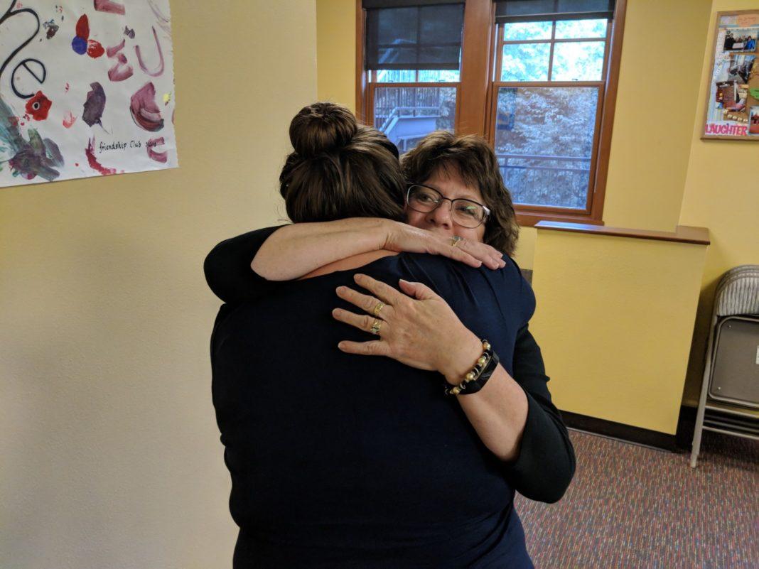 South Sound Parent to Parent Kim Smith hugging an employee