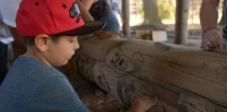 Younger child sanding