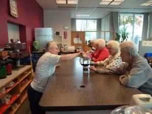 Panorama Help Homeless Seniors Serving Coffee at Senior Center