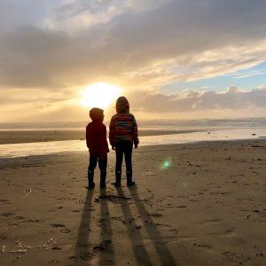 Playful Wisdom kids on beach