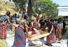 Friendly Water for the World women sifting gravel