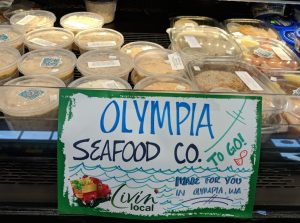 Spuds Produce Market Olympia Seafood company cold case sign