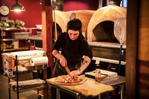 Stone Creek Wood Fired Pizza Employees Slicing Pizza Morgan