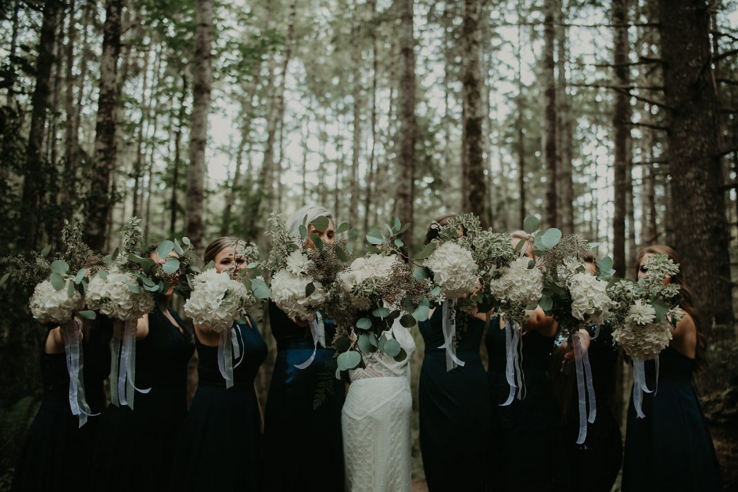 Oly Events Bride and bridesmaids with flowers