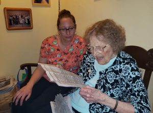 Advanced Health Care Procare Academy Alanna and Lucille with newspaper