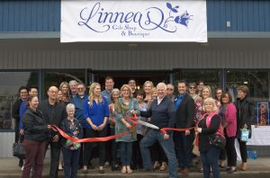 Alongside friends new and old, Linnea Grantham cuts the ribbon to officially open her new store.