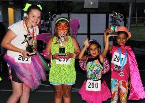 Glow in the Dark 5k dressed up children pose
