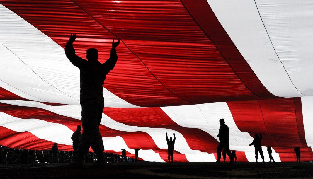 Nellis, Creech Airmen raise American Flag during Las Vegas Bowl
