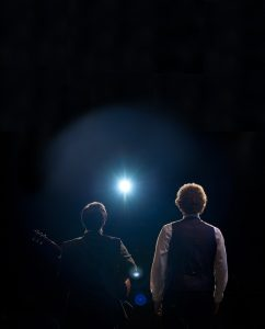 Washington Center for the Performing arts The Simon and Garfunkel Story performing on stage with dark background
