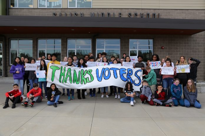 students outside the new Salish middle school