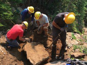 Mt Rose Trail Crew Cutting Rock