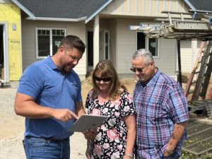 Northwest Home Team Steve Poulos with Clients