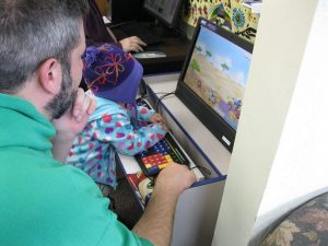 Timberland Regional Library Kid & Dad on Computer Mountain View