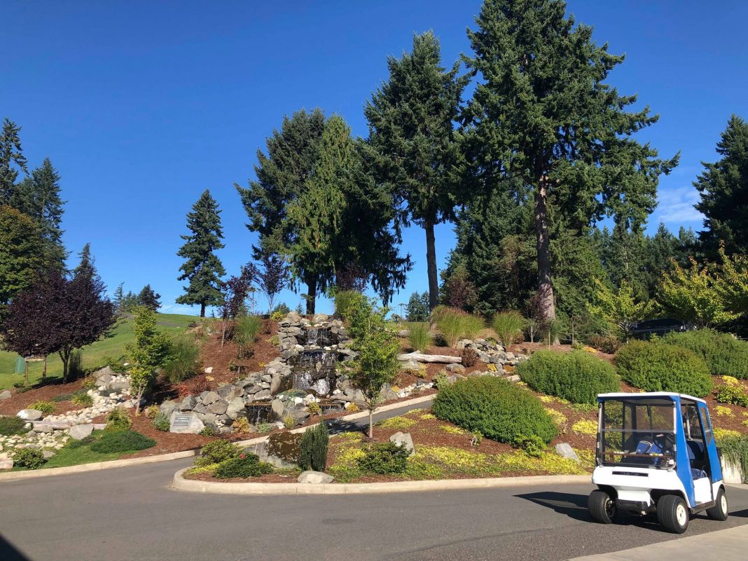 waterfall and golf cart at Olympia Country and Golf Club