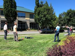 SCJ Alliance ESOP Lacey employees playing corn hole at lunch