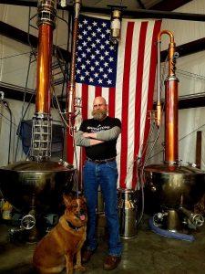 Tenino-Sandstone-Distillery-John-Bourdon-stills-and-flag