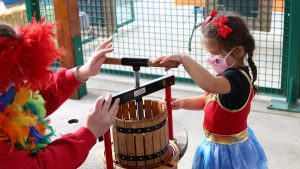 Hands on Childrens Museum Boo Bash Pressing Apple Cider